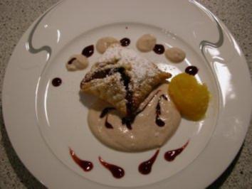 Blätterteigtasche mit Rotweinpflaume und Maronensauce an Orangen-Sorbet - Rezept