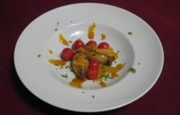 Tintenfische gegrillt mit Wintermangold, gebackenen Tomaten u. Mandarinenfilets - Rezept