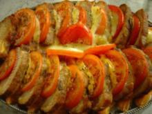 Lachs-Braten vom Schwein mit Käse und Tomaten - Rezept