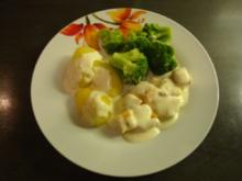 Lachs mit Kräuterfrischkäse-Soße - Rezept