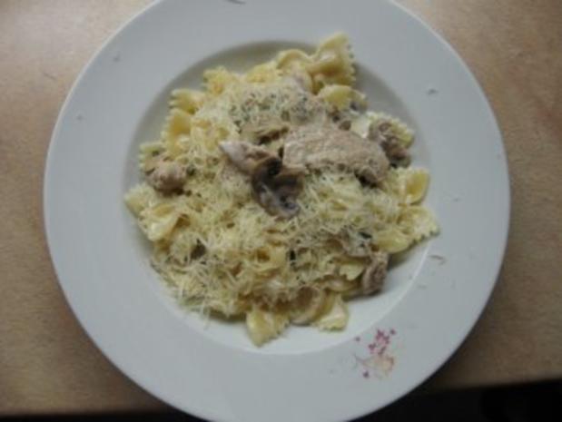 Farfalle mit Schweinefleisch und Champignon - Rezept