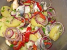 Kartoffelsalat mit Heringsfilet - Rezept