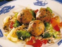 Wels-Klöße auf Gemüseragout - Rezept