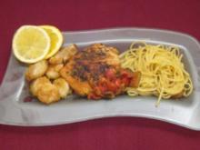 Linguine con scampi, pomodori e zucchini in sugo di Vino Bianco, dazu Fisch - Rezept