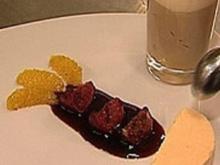 Grand-Marnier-Parfait mit Gewürzorangen und Tobleronemousse mit Eierlikörhäubchen an Barolo-Feigen - Rezept