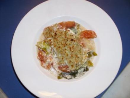 Seelachs unter Haube auf Gemüsebett - Rezept