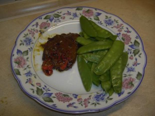 Fleisch - Steffis Schweineschnitzel in  Curry-Orangensoße mit Kaiserschoten - Rezept