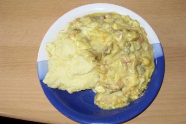 Eier in Schinken-Curry-Soße - Rezept