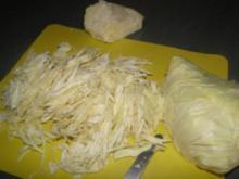 Spitzkohl mit Kartoffelpüree und Pilze untereinander, dazu Putenschnitzel   (Fotos) - Rezept