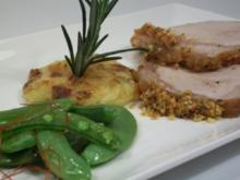 Rücken vom Mangalica-Schwein an Dauphinoise und Erbsenschoten - Rezept