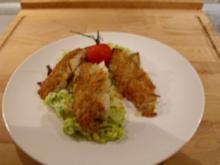 Zanderfilets unter der Kartoffelkruste auf Lauchgemüse in Keta-Kaviar-Schnittlauch-Sauce - Rezept