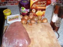 Zwiebelbraten mit Rotkohl und Knödel - Rezept