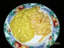 Huhn  gewürfelte Hühnerfleisch in einer Curry-Sahne-Sauce (hausgemacht) - Rezept