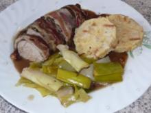 Schweinefiletkopf mit Kräutern im Lauchmantel geschmort - Rezept