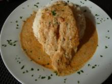 Pangasiusfilet in Tomaten-Kräutersauce auf Reisbett - Rezept
