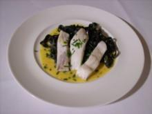 Steinbuttfilet auf schwarzen Bandnudeln an Safran- Wermut-Soße - Rezept