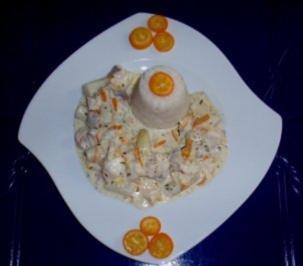 Spargel-Rotbarsch-Ragout in Kumquats-Sahnesoße und Reistürmchen - Rezept