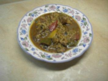 Suppen - Eintöpfe - Kaninchen-Kalbs-Stew mit Reis und Salsiccia - Rezept