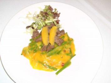 Rindfleischstreifen und Gemüse an Orangenfilets - Rezept