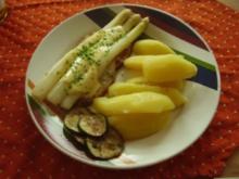 Schweinelachssteak mit Spargel und Kartoffeln und Zucchinischeiben - Rezept