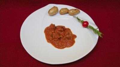 Dattel-Albondigas an scharfer Oliven-Tomatensoße mit Bratlingen (Kalle Pohl) - Rezept