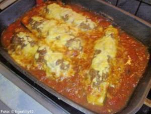 Gefüllte Zucchini in Tomatensauce - Rezept
