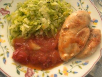 Hähnchenbrust in Tomaten u.Knoblauch geschmort - Rezept