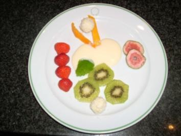 Kokos-Sahne-Pralinen an Weinschaum und exotischen Früchten - Rezept