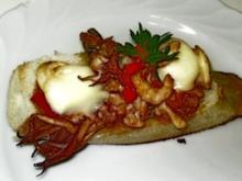 Überbackente Meeresfrüchte auf  Baguettes - Rezept