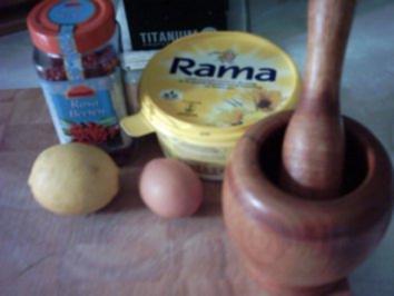 Pangasiusfilet mit karamellisierten Zitronenschale, Kräutersoße und Kartoffelnüsse - Rezept