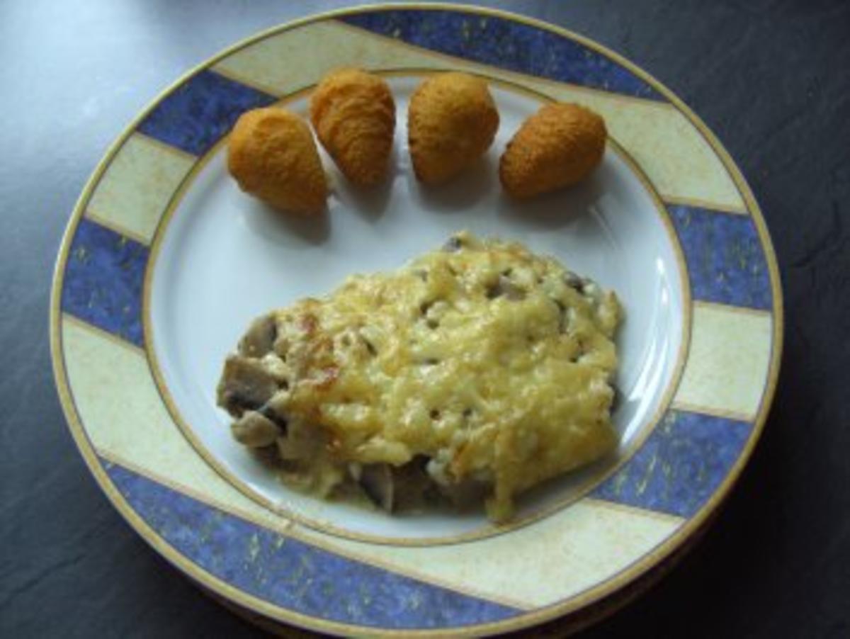 Schweinefilet mit Champignon-Käse überbacken - Rezept