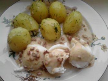 Verlorene Eier in Schinkensahne - Rezept