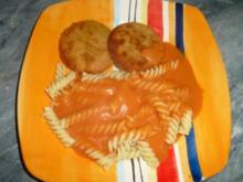 Jägerschnitzel mit Tomaten-Sahne-Soße - Rezept