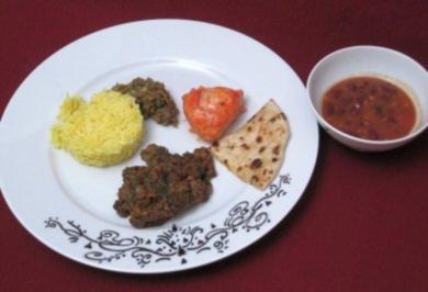 Rindergulasch in Spinat-Vindalho und Tandoori-Hähnchen an Basmatireis - Rezept