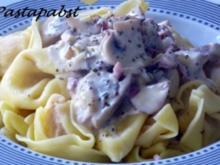 Tortellini mit Champignon-Rahm-Sauce - Rezept