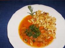 Schweinshaxenscheiben mit Gemüse geschmort - Rezept