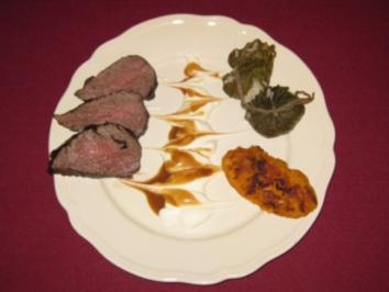 Rinderfilet in Tee mariniert mit Reis im Weinblatt und Karotten-Köfte - Rezept
