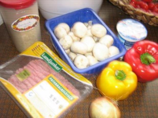 Gefüllte Paprika mit Putenhack, Champignons und Reis - Rezept - Bild Nr. 2