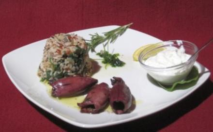 In Rotwein gebratene Tintenfische im Kräutersud, dazu Reis mit Spinat - Rezept