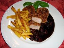Schweinemedaillons im Haselnussmantel an Sauerkirsch-Schokosoße - Rezept
