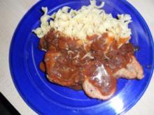 Fleischgerichte:Naturschnitzel mit Champignon-Rotweinsoße - Rezept