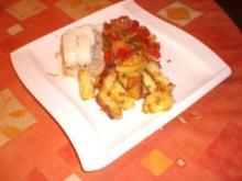 Gefülltes Heilbuttfilet mit parnierten Bratkartoffeln und Paprika-Tomatengemüse - Rezept