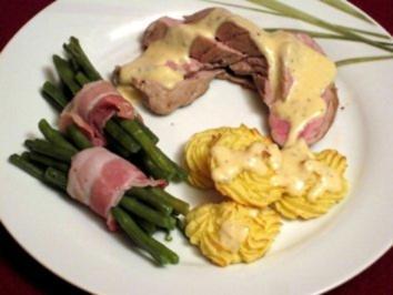 Rezept: Schweinefilet in Sahnesoße mit Herzogin-Kartoffeln und Bohnen im Speckmantel