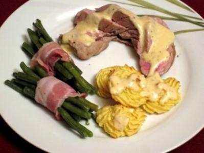 Schweinefilet in Sahnesoße mit Herzogin-Kartoffeln und Bohnen im Speckmantel - Rezept