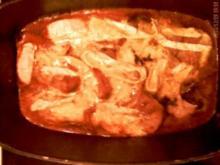 Überbackene Kalbsschnitzel in Tomatensoße - Rezept