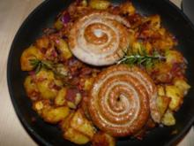Bratkartoffeln mit Bratwurstschnecken und einem Rosmarinaroma - Rezept