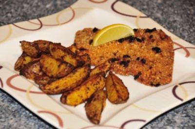 Schnitzel mit Haselnuss-Rosinen-Panade und Wedges - Rezept