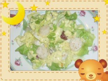 Jakobsmuscheln mit Mango-Curry-Dip auf Salatblatt - Rezept