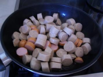 Zucchini-Pfanne mit Würstchen - Rezept