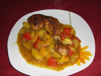 Aus dem Ofen: Hähnchenschenkel auf Paprika-Kartoffel-Gemüse - Rezept